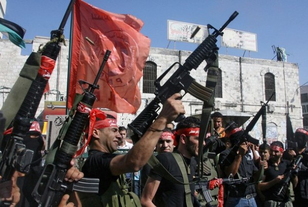 PFLP fighters march to commemorate PFLP leader Abu Ali Mustafa.