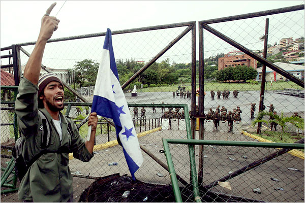 A pro-democracy protestor sings the national anthem outside the presidential palace (Oswaldo Rivas/Reuters).