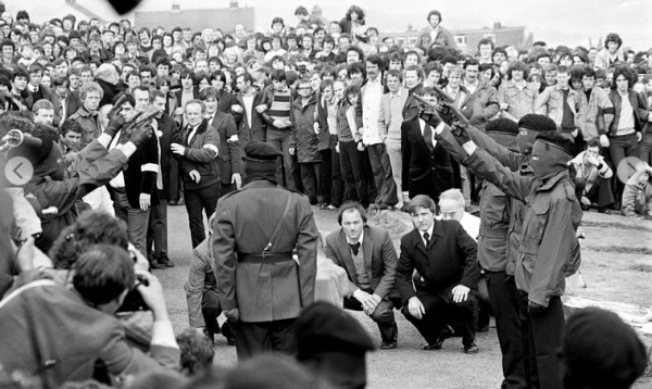 Irish National Liberation Army volunteers fire shots over the casket of INLA hunger striker Patsy O'Hara who was murdered by then Prime Minister Margret Thatcher (photo courtesy of BBC).